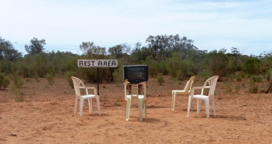 Broken chairs and television in the outback