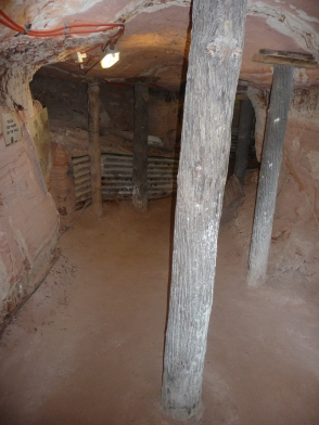 Sandstone opal mine cavern and timber support posts